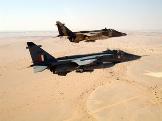 An IAF and RAFO Jaguar fly as a pair over the desert terrain during the joint air exercise Eastern Bridge at Oman-734972